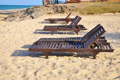Beach chairs on sand beach. Concept for rest, relaxation, holida Stock Photo