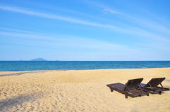 Beach chairs on sand beach. Concept for rest, relaxation, holida Royalty Free Stock Images