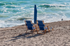 Beach chairs on sand Royalty Free Stock Images
