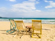 Beach chairs on the sandy beach. Coast of the Black Sea. South Beach, Varna, Bulgaria Royalty Free Stock Photography