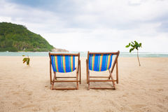 Beach chairs at sea front Stock Images