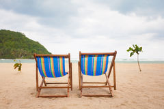 Beach chairs at sea front Royalty Free Stock Images