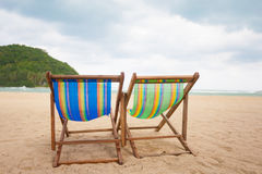 Beach chairs at sea front Stock Photography