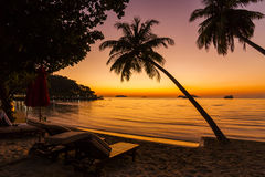 Beach chairs on the shore of a tropical island. Stock Image