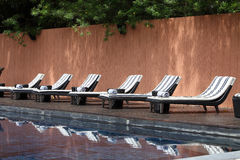 Beach Chairs side Swimming Pool. Stock Images