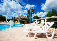 Beach chairs side swimming pool Royalty Free Stock Photography