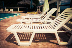 Beach chairs side swimming pool Royalty Free Stock Images