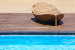 Beach chairs side swimming pool Stock Photos