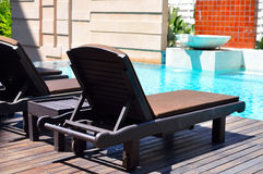 Beach chairs side swimming pool Stock Photo