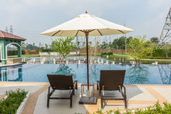 Beach chairs side swimming pool at Thailand Stock Image