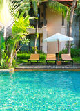 Beach chairs side swimming pool Royalty Free Stock Photo