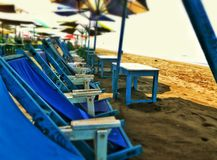 Beach chairs. Sit down empty chairs royalty free stock images