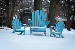 Beach Chairs in the Snow. Shows the irony of 3 beach/lawn chairs sitting in the snow stock photos