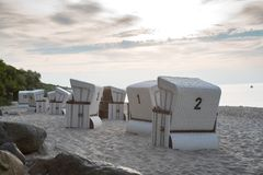 Beach Chairs Strandkorb on the beach in Germany Ostsee. Beach Chairs on the beach in Germany Ostsee, its noon and you see nice clouds white sand an the sea Stock Photos