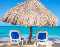 Beach Chairs and Straw Umbrella on the beach Royalty Free Stock Image