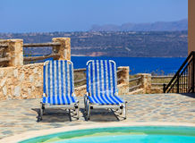 Beach chairs on summer vacation in Europe Royalty Free Stock Photos
