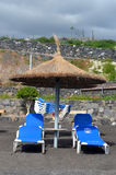 Beach chairs and sun umbrellas Royalty Free Stock Photo