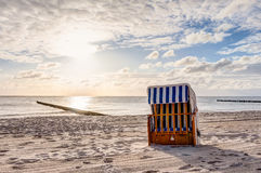 Beach chairs after sunrise Stock Images