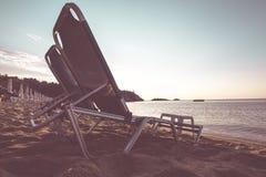 Beach chairs at sunrise Stock Photos