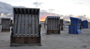 Beach chairs with sunrise Royalty Free Stock Photography
