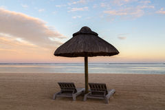 Beach chairs at sunset Le Morne Mauritius.  Royalty Free Stock Photography