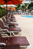 Beach chairs and swimming pool Stock Image