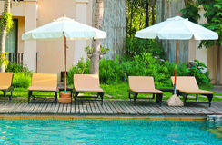 Beach chairs and swimming pool Royalty Free Stock Photos