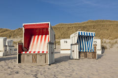Beach chairs at Sylt. Typical beach chairs at Sylt, dunes in background stock photography