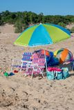 Beach chairs and toys for summertime fun Royalty Free Stock Photos