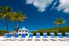 Beach chairs. On tropical beach Royalty Free Stock Photos