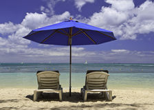 Beach chairs on tropical vacation. Beach chairs on tropical beach in Mauritius island Stock Images