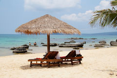Beach chairs on tropical island, Cambodia Stock Images