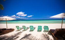 Beach chairs on tropical perfect white sandy beach Royalty Free Stock Photo