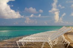 Beach chairs in a tropical pool in the Bahamas Royalty Free Stock Photos