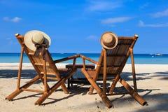Beach chairs on tropical sand beach in Boracay, Philippines. Hats on beach chairs of tropical sand beach in Boracay, Philippines Royalty Free Stock Photography