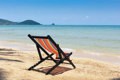 Beach chairs on  tropical sand beach. Royalty Free Stock Images