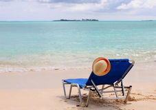 Beach chairs on the tropical shore, vacation Stock Image