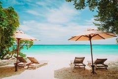 Beach chairs on tropical vacation. Beach travel Stock Photos