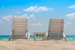 Beach chairs on tropical white sand beach . Royalty Free Stock Photos