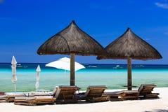 Beach chairs on tropical white sand beach Stock Photos