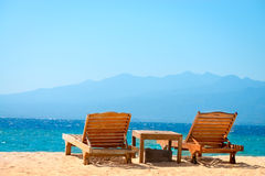 Beach chairs on tropical yellow sand beach Royalty Free Stock Images