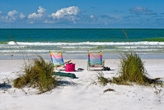 Beach Chairs. Two Colorful Beach Chairs and Tote Bag on the Florida Coast Stock Photography