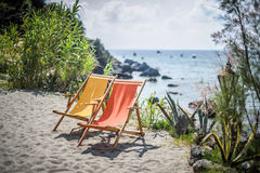 Beach chairs. Two picturesque beach chairs on the background of the Tyrrhenian sea Royalty Free Stock Image