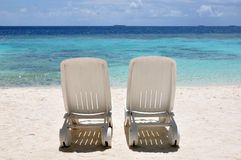 Beach Chairs. Two plastic beach chairs on a tropical beach Stock Image