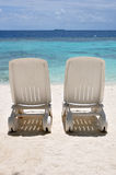 Beach Chairs. Two plastic beach chairs on a tropical beach Royalty Free Stock Photo