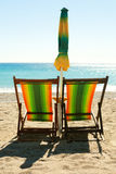 Beach with chairs and umbrella Royalty Free Stock Images