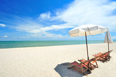 Beach chairs with umbrella. On a sunny day stock photos
