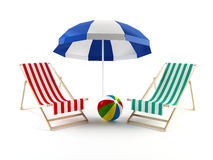 Beach chairs and umbrella Stock Photos