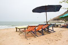 Beach chairs with umbrella Stock Image