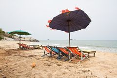 Beach chairs with umbrella Stock Photos